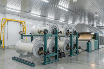 machine evaporates textile yarn. machinery and equipment in a textile factory