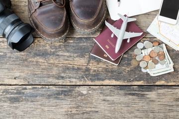Preparation for travel, money and passport on wooden table,Top view