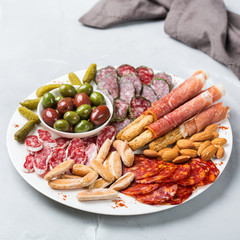 Assortment of spanish tapas or italian antipasti with meat