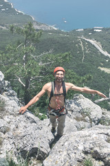man rock climber climbs on the cliff