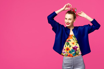 Young beautiful girl in a blue blouse on a pink background. Colour obsession concept.  Minimalistic style. Stylish Trendy