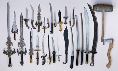 collection of medieval swords, knives and daggers