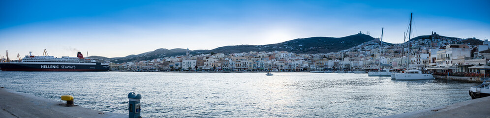 Ermoupoli, Syros - Greece.  Panoramic view of the harbor and the traditional houses of Syros island in Greece.