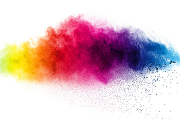 Abstract multi color powder explosion on white background.  Freeze motion of  dust  particles splashing. Painted Holi in festival