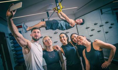 Sporty people taking selfie photo in gym