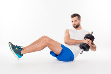 Full size portrait of active, athletic, sporty, attractive, professional, successful, confident guy making, showing abdominal crunches with weights, isolated on white background