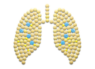 Overhead view of medicines arranged as lungs over white background