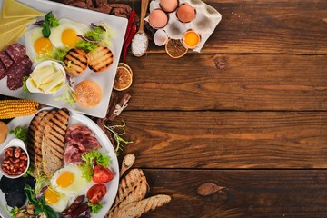 Set breakfast. Eggs, yogurt, fruits, cheese. Top view. On a wooden background. Copy space.