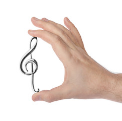 Wall Mural - Hand holding a treble clef