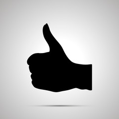Black silhouette of hand in thumbs-up gesture