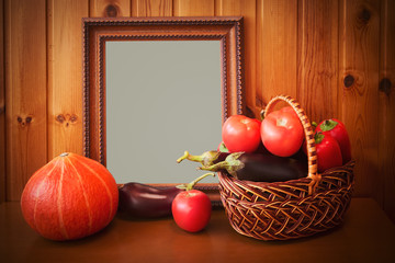 Fresh vegetables and picture frame