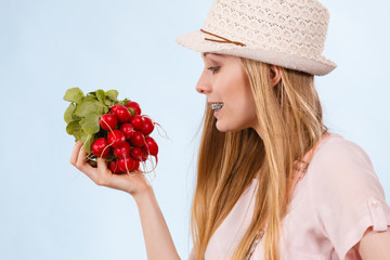 Happy woman holding radish