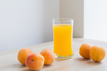 peach juice on wooden table