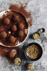 Raw bliss balls: hazelnut, coconut, dates coated with raw cocao powder.  2nd bliss balls are coasted with toasted buckweat.