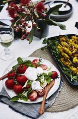summer picnic: mediterranean salad, turmeric chicken skewers.