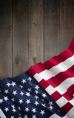 American Flag Fourth of July on Old Wood Background vertical