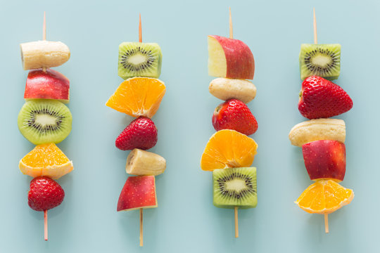 fruit skewers the concept of healthy eating / pastel turquoise glass background.