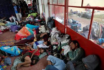 Central American migrants, part of a caravan moving through Mexico toward the U.S. border, sleep at a sports centre in Matias Romero