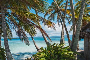 Papiers peints Plage palm trees hut and ocean - tropical island landscape -