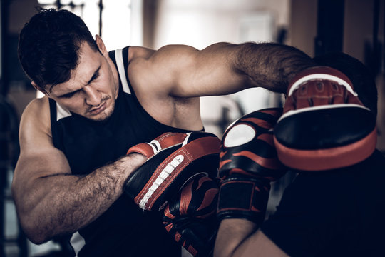 Boxing workout with trainer and punch mitts