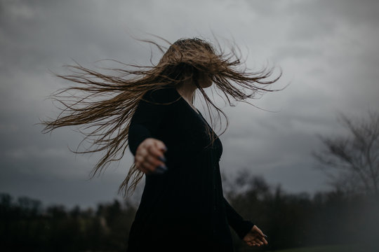 Woman With Long Hair Blowing in the Wind