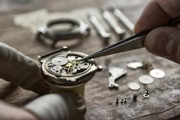 Process of installing a part on a mechanical watch, watch repair Wall mural