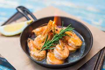 shrimp with fire in a frying pan
