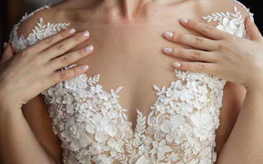 Pink manicure and neckline wedding dresses
