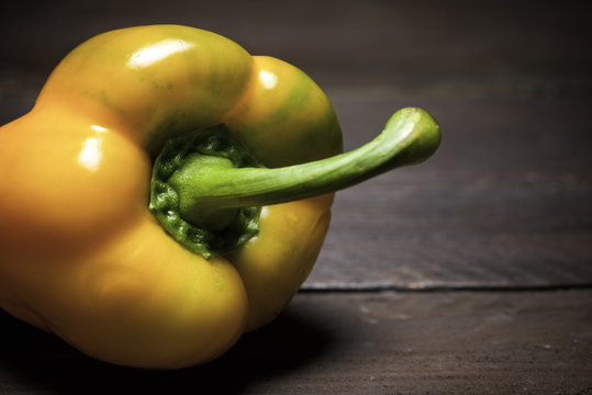 Close-up of yellow bell pepper on wooden table