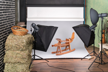Process of studio photography of a child toy - a wooden plane swing