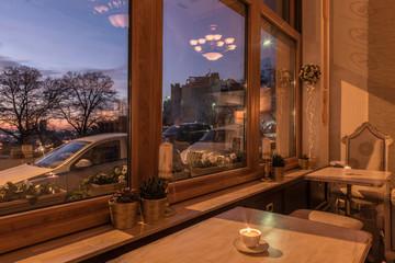 Scenic view at nightfall through window of luxury restaurant