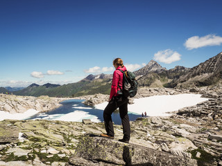 sportive woman standing on top of a mountain in the alps  and enjoying the view