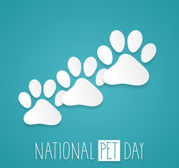 National Pet Day. Paws on blue background with handwritten text. Vector illustration.