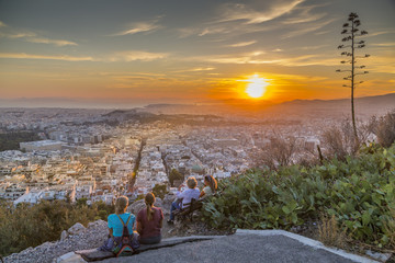 People watching sunset over Athens from Likavitos Hill, Athens, Greece, Europe