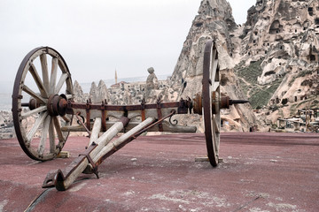 wooden old coach in Uchisar and Cappadocian cave homes