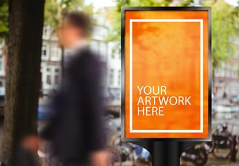 Advertising Kiosk with Blurred Walking Man Mockup