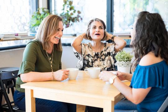 Friends enjoying at coffee shop