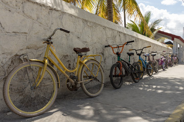 Caribbean Town in Mexico fosters kids Independence. Children ride their bikes to school and park them against the wall.