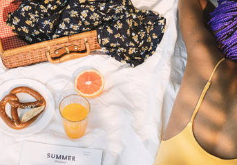 Girl in swimsuit having a picnic