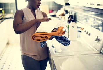 Black woman doing the laundry