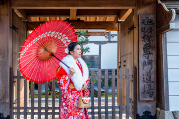 Wall Mural - Asian women wearing japanese traditional kimono visiting the beautiful in Kyoto.