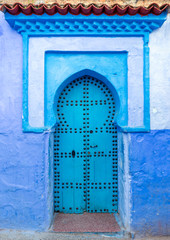 Old blue door on street in Chefchaouen