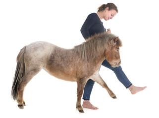 Falabella miniature horse and girl