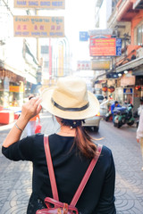 Asian tourist women travel in Yaowarat Chinese road for shopping