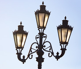Ancient street lamp on the sky background