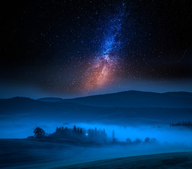 Small farm and milky way at night, Italy