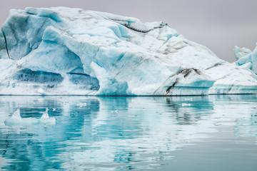 Stunning icebergs floating on blue lake, Iceland