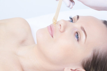 Cosmetic procedure for hair removal. Beauty and health. Bright skin