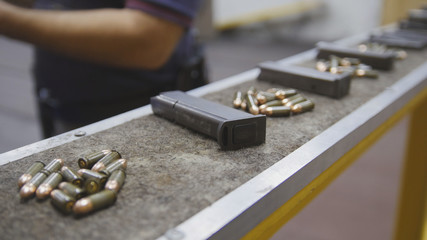 Pistol clips with bullets in shooting gallery