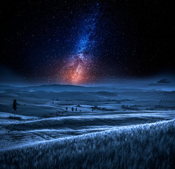 Fototapete - Milky way and field in Italy at night